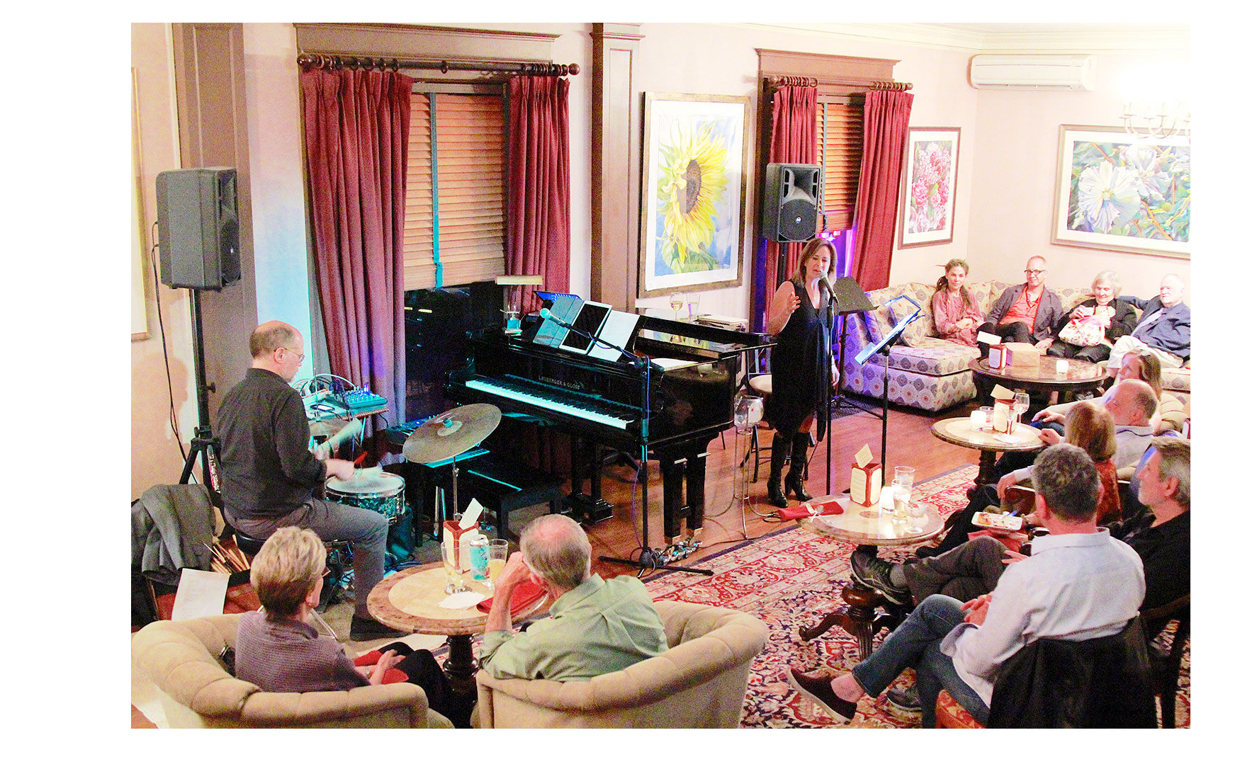Live music in the lounge with many people sitting and enjoying the music.